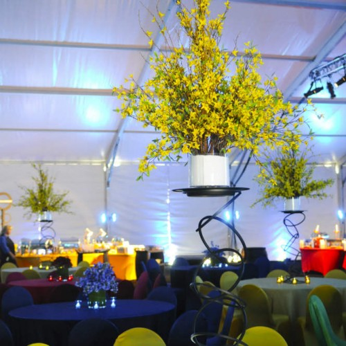 International tent event candle and floral centerpieces