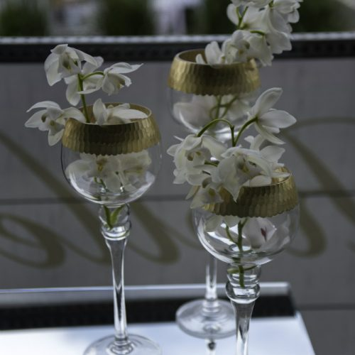 Upsher Casino Gold Rimmed vase with white orchids