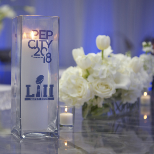 Events Forum Pepsi Ice candle & flowers centerpiece