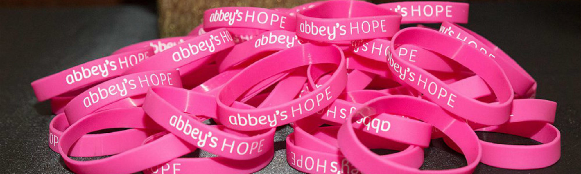 Abbey's Hope wrist bands by centerpiece slider