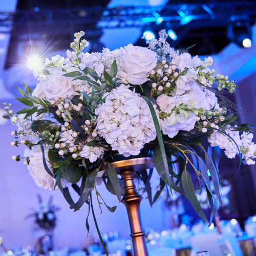 Italian dinner floral centerpiece in blue room
