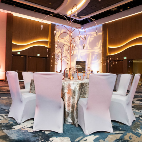 BATC Gold Table with White Chairs