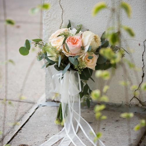 Jennifer&Charlie Spevacek Olson flowers against wall