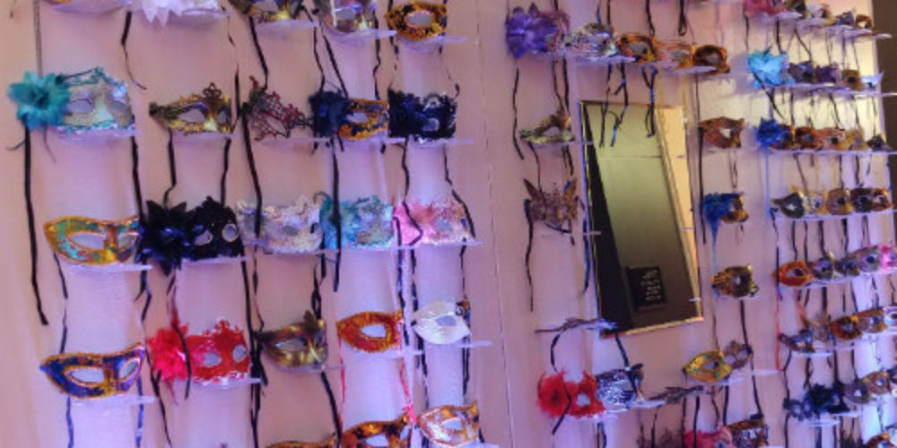 Advisornet Masquerade mask wall